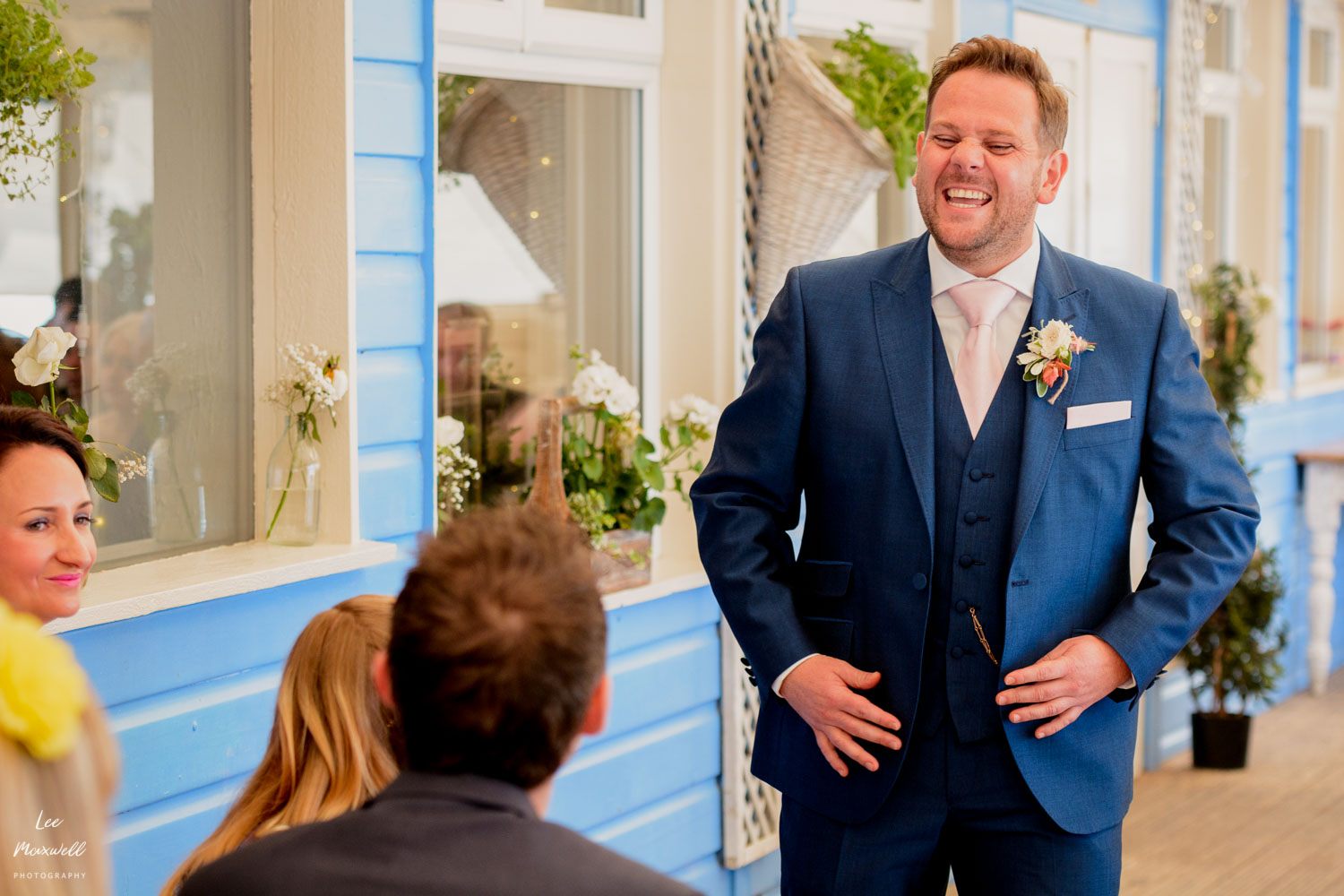 Laughing groom