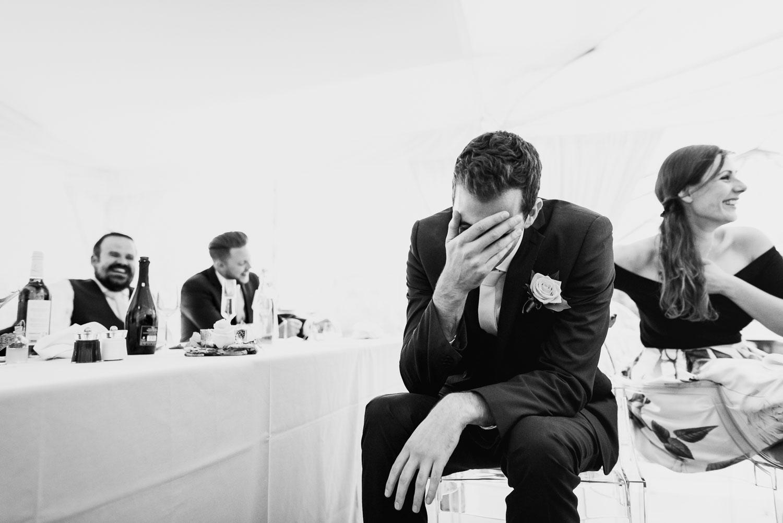 Embarrassed groomsmen at speech