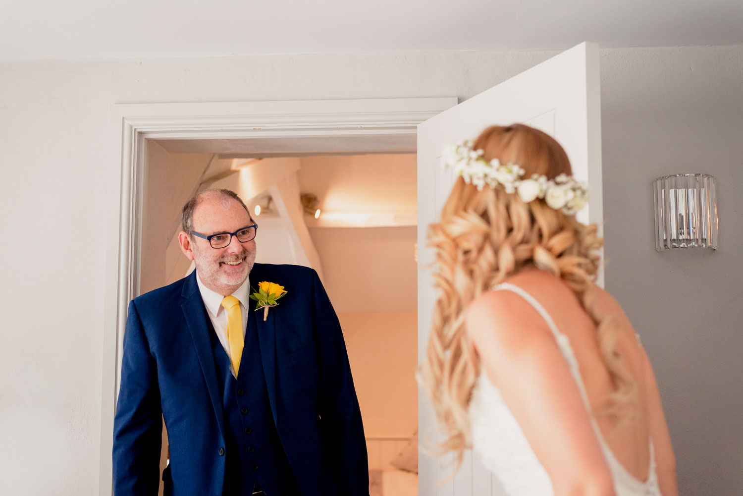 Dad see daughter in wedding dress