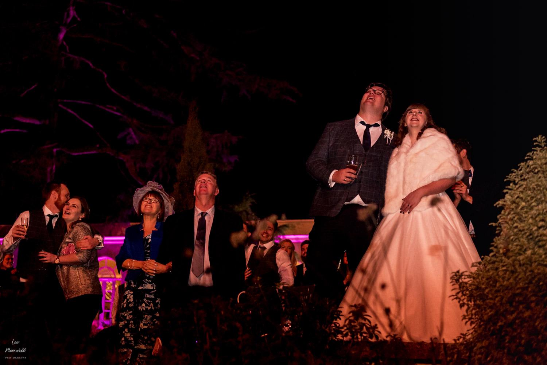 Wedding guests watch fireworks at Deer Park