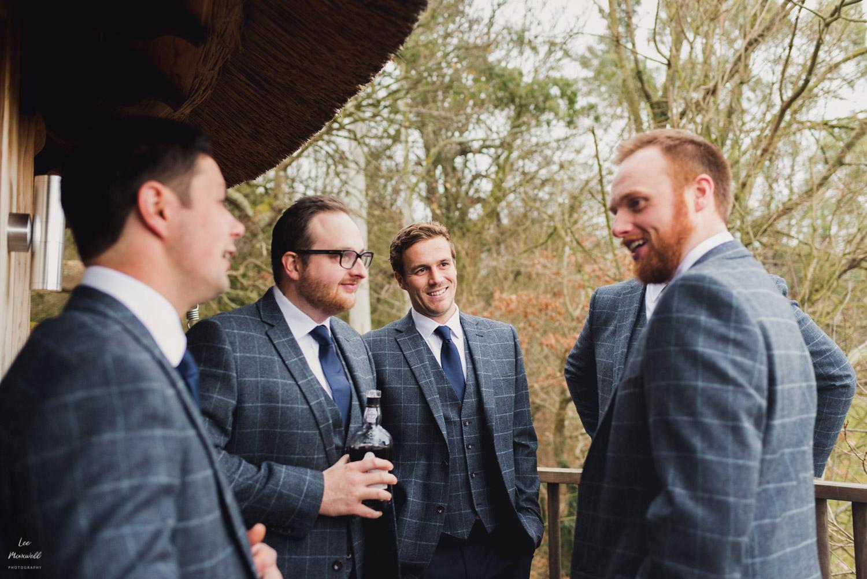 Chatting groomsmen