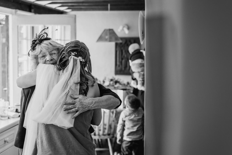 Bride and mum hug on wedding morning