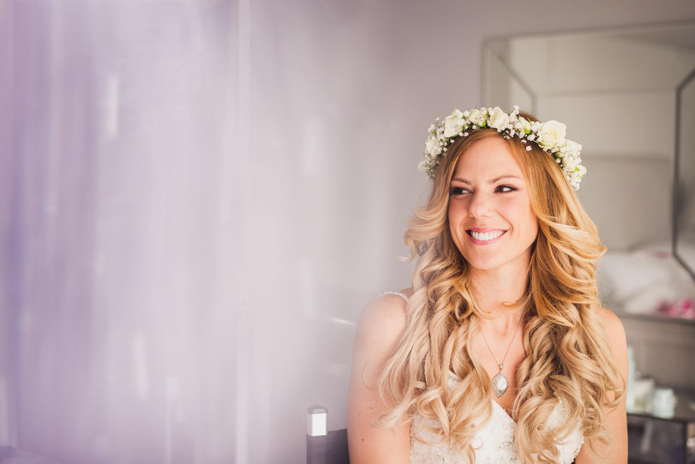 Smiling bride during prep