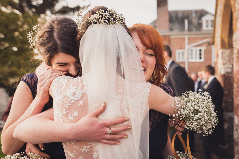 Hugging bridesmaids