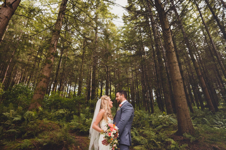 Relaxed woodland wedding portrait