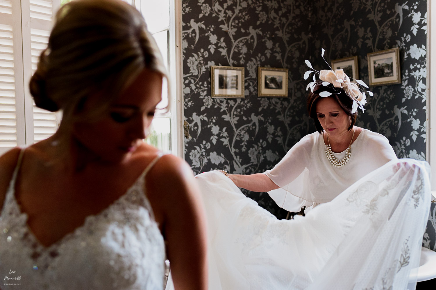 Mum helping with wedding dress