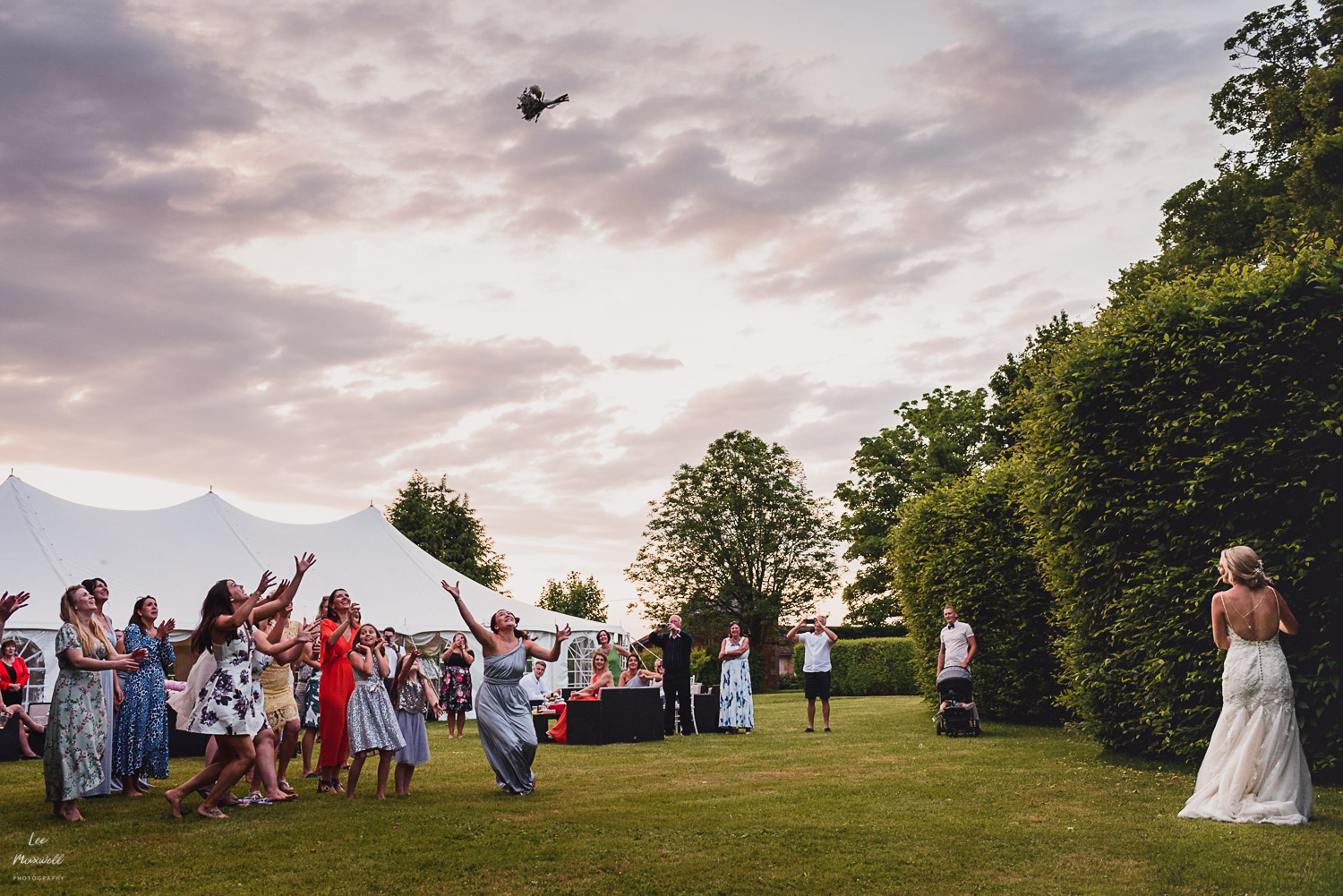 Throwing the bouquet at Chateau La Durantie, France.