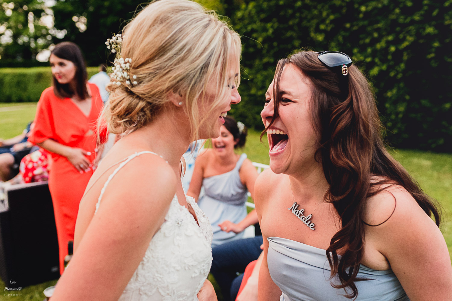Laughing bridesmaid