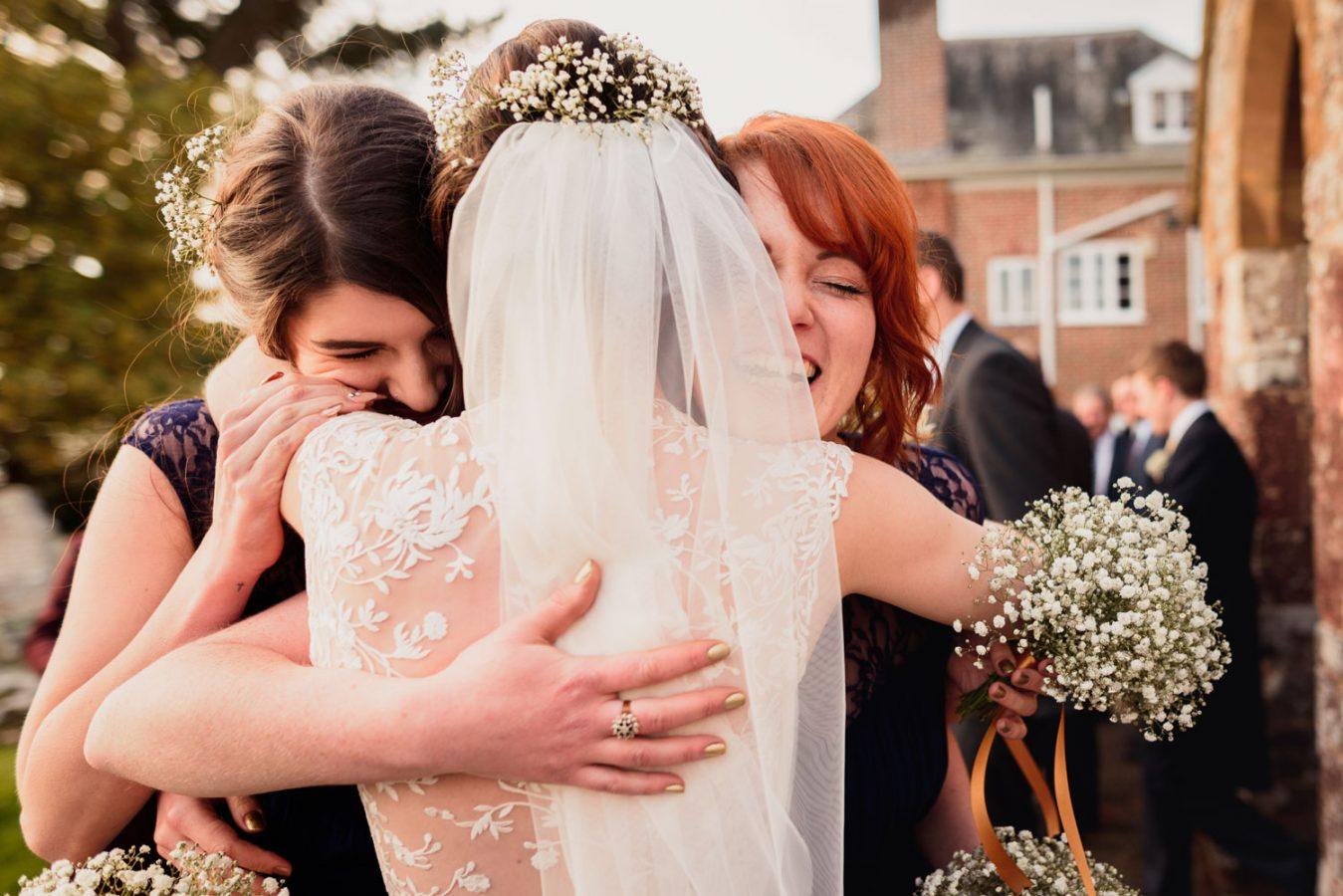 Friends hugging the bride
