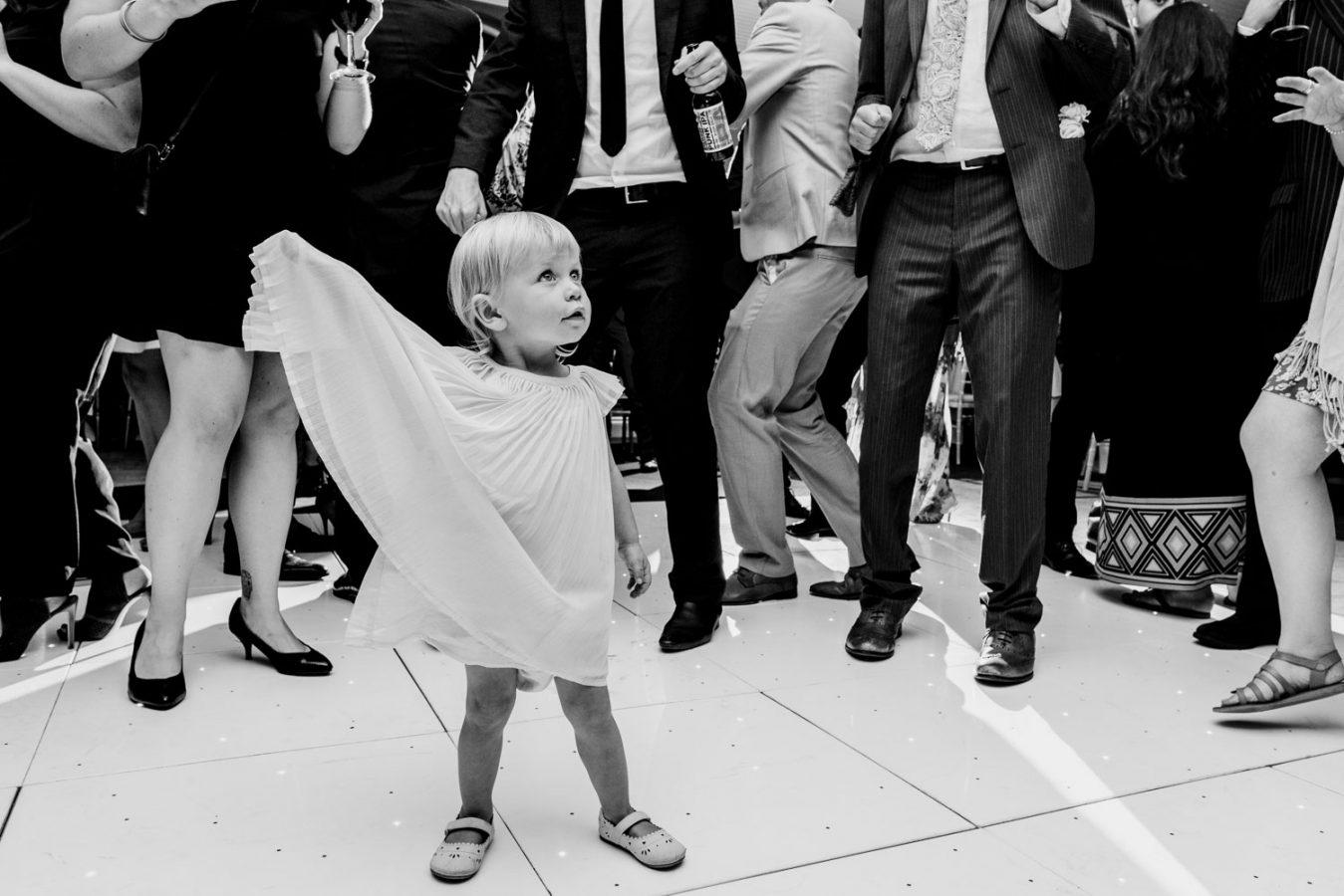 Little girl bossing the wedding dance floor