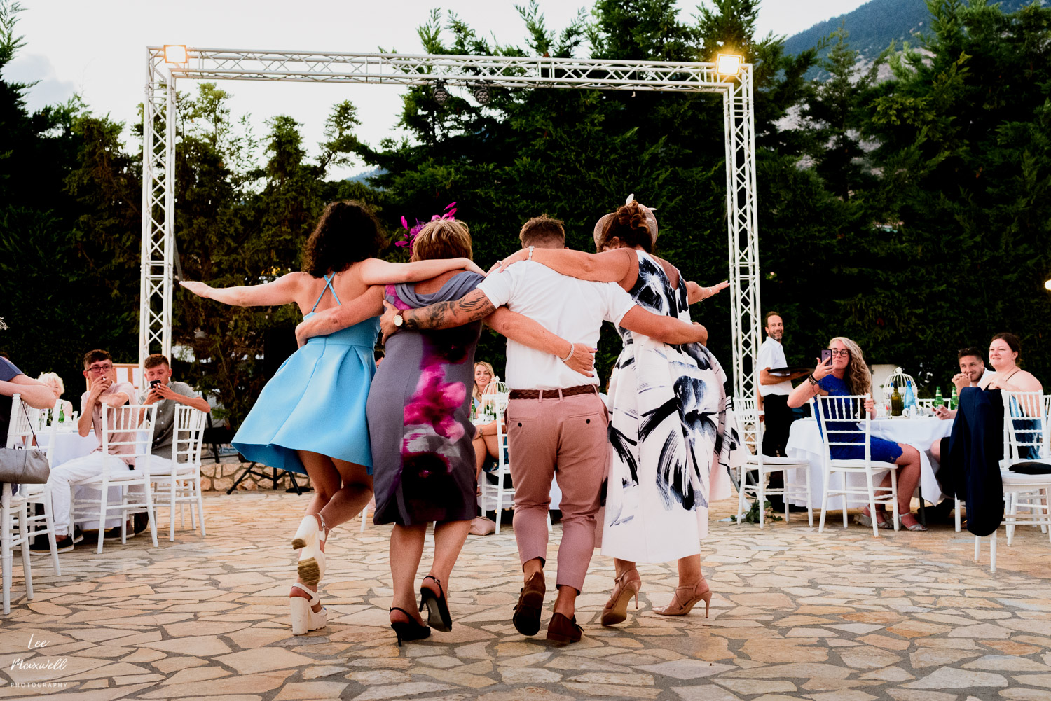 Guests dancing in Greek wedding