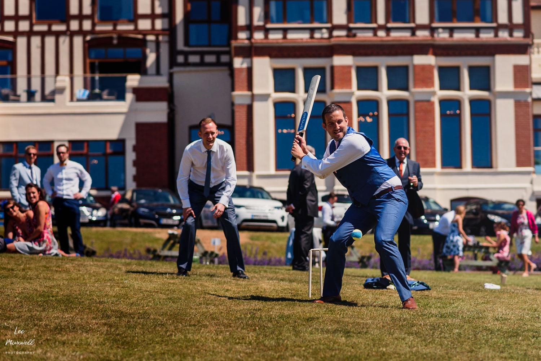 Best man playing cricket