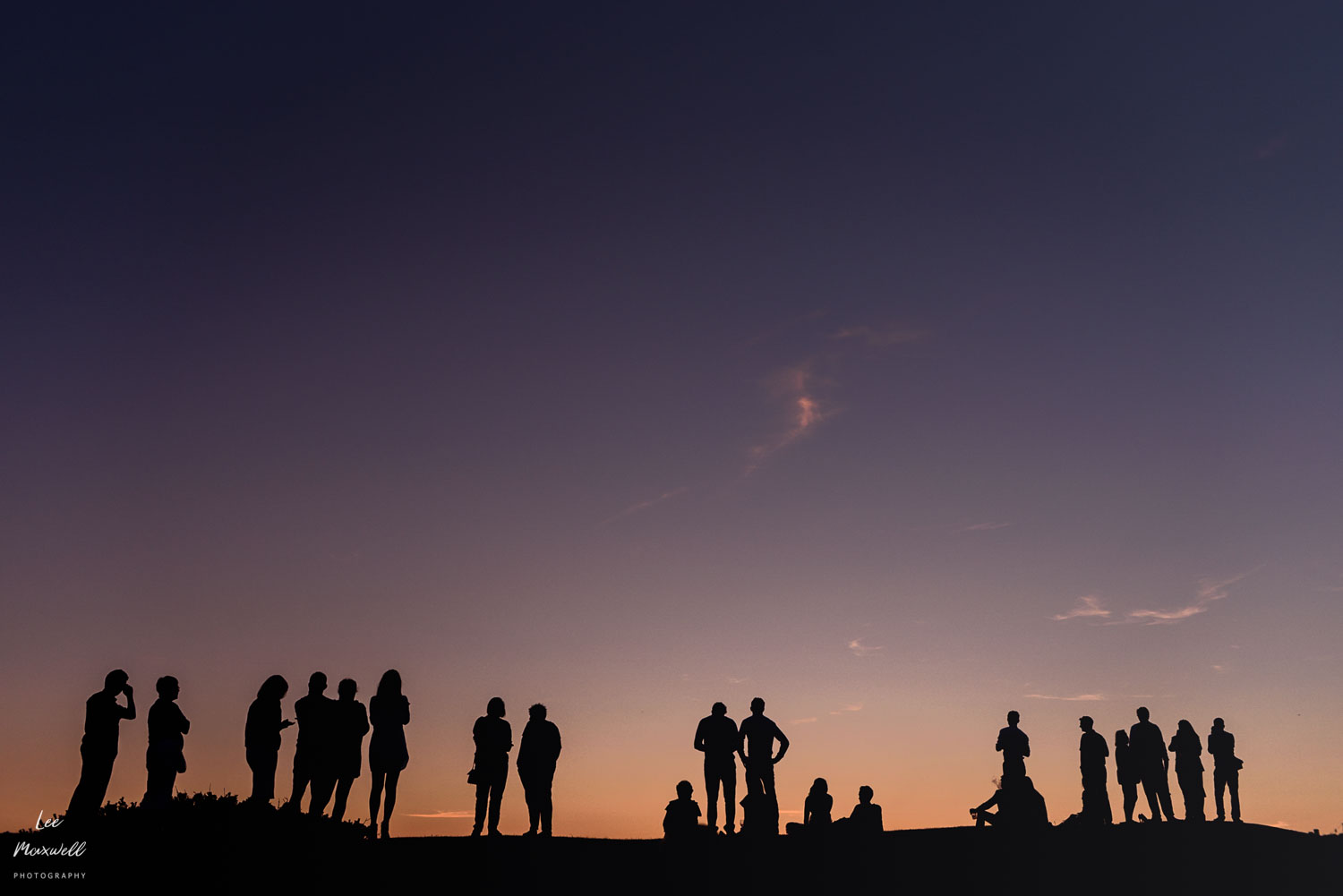 Wedding guests at sunset