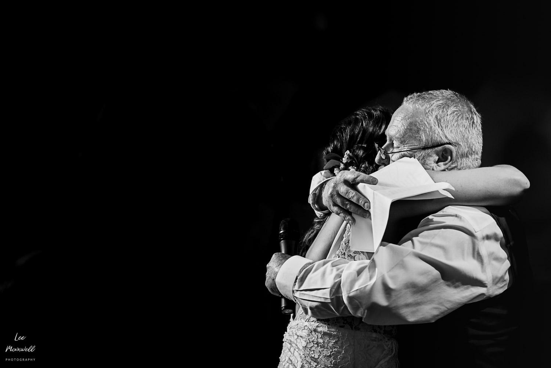 Bride hugging dad after speech
