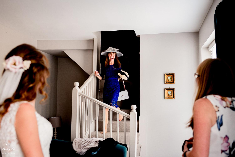 Mum walking downstairs