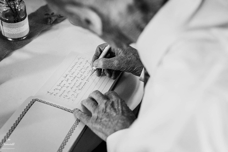 Granddad signing book