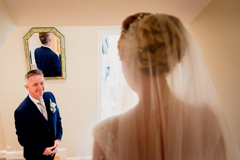 Bride walking downstairs to dad