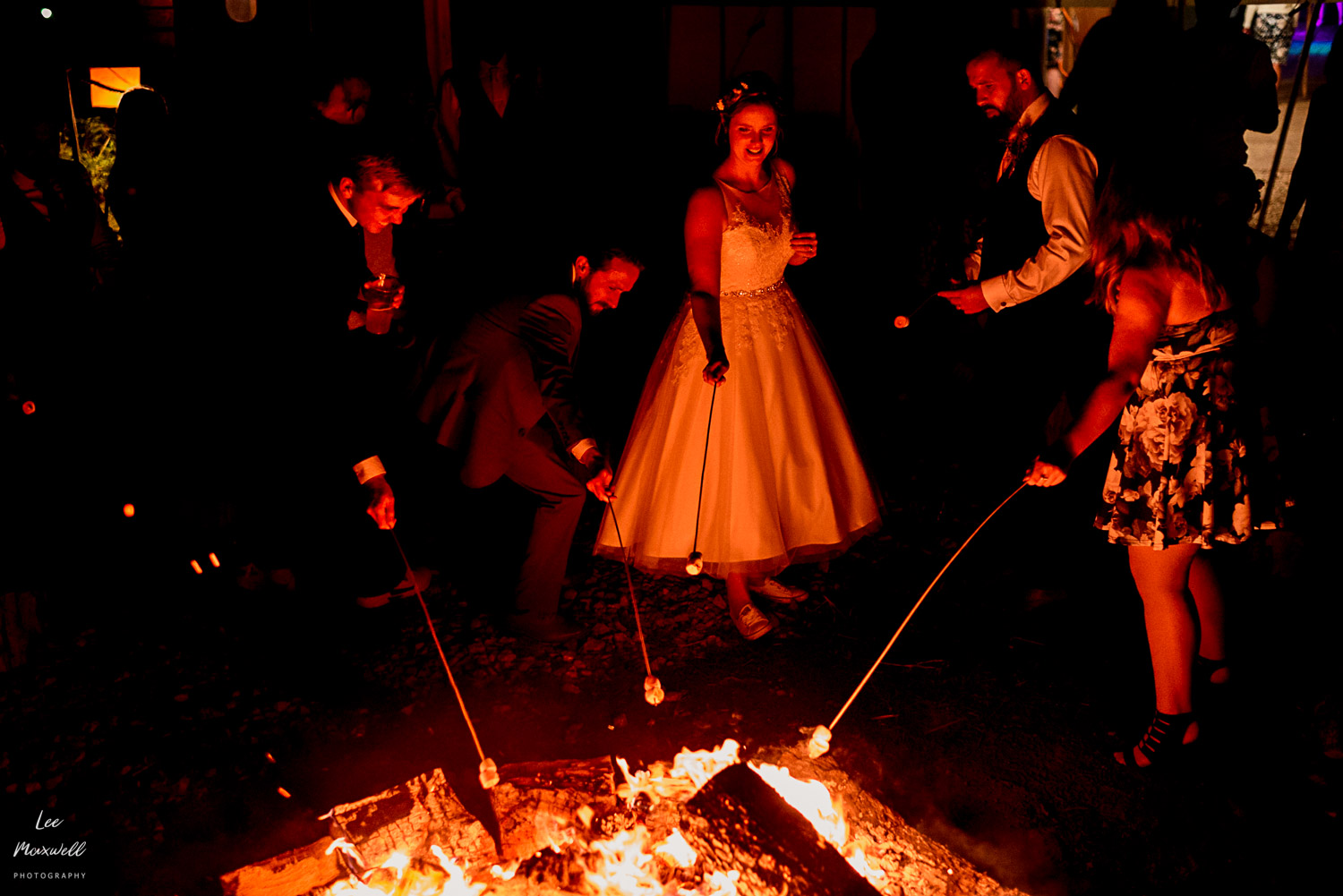 Roasting marsh mellows at wedding