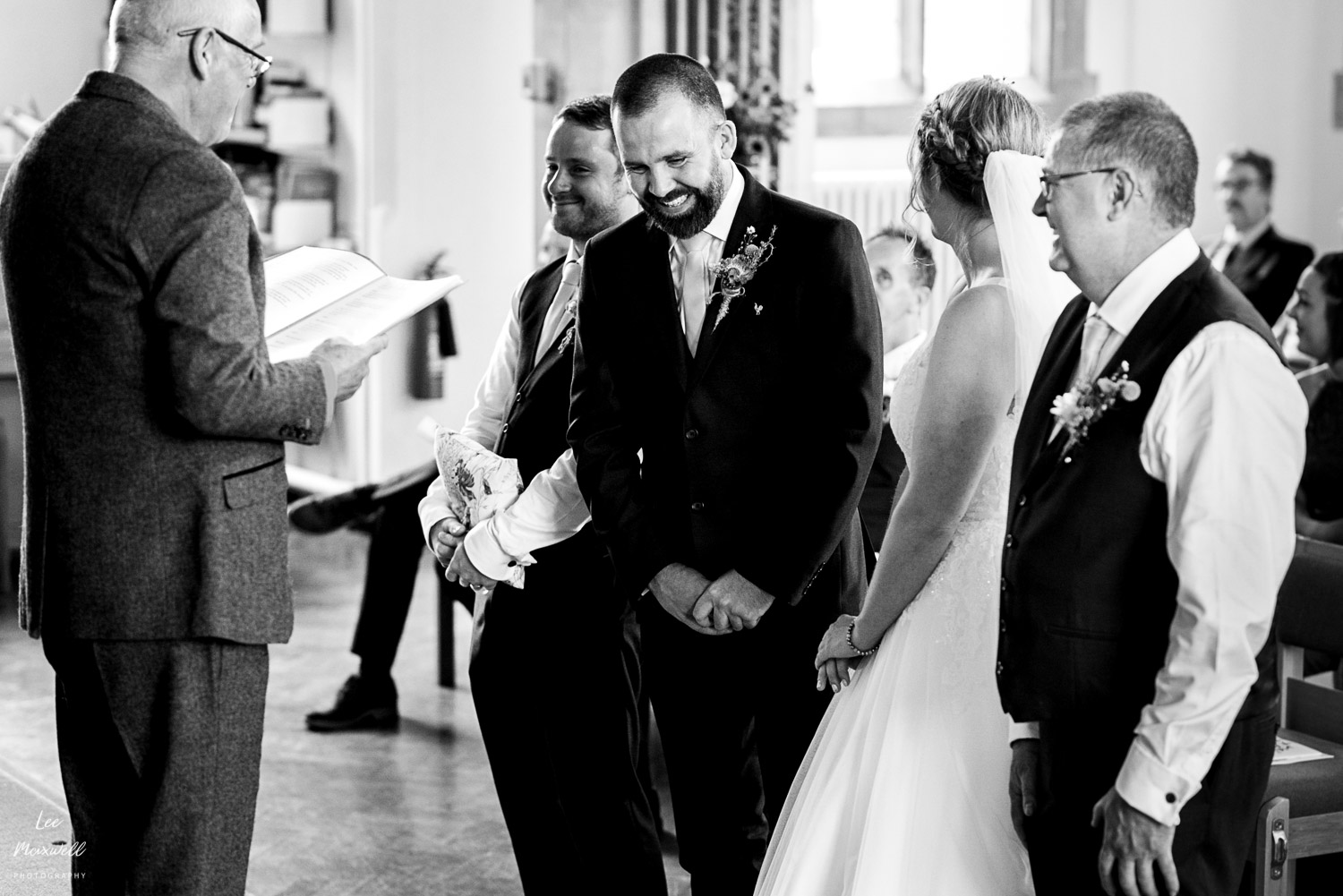 Laughing groom at ceremony