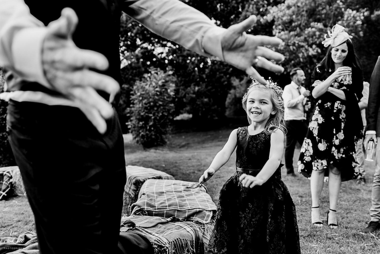Wedding guests doing floss