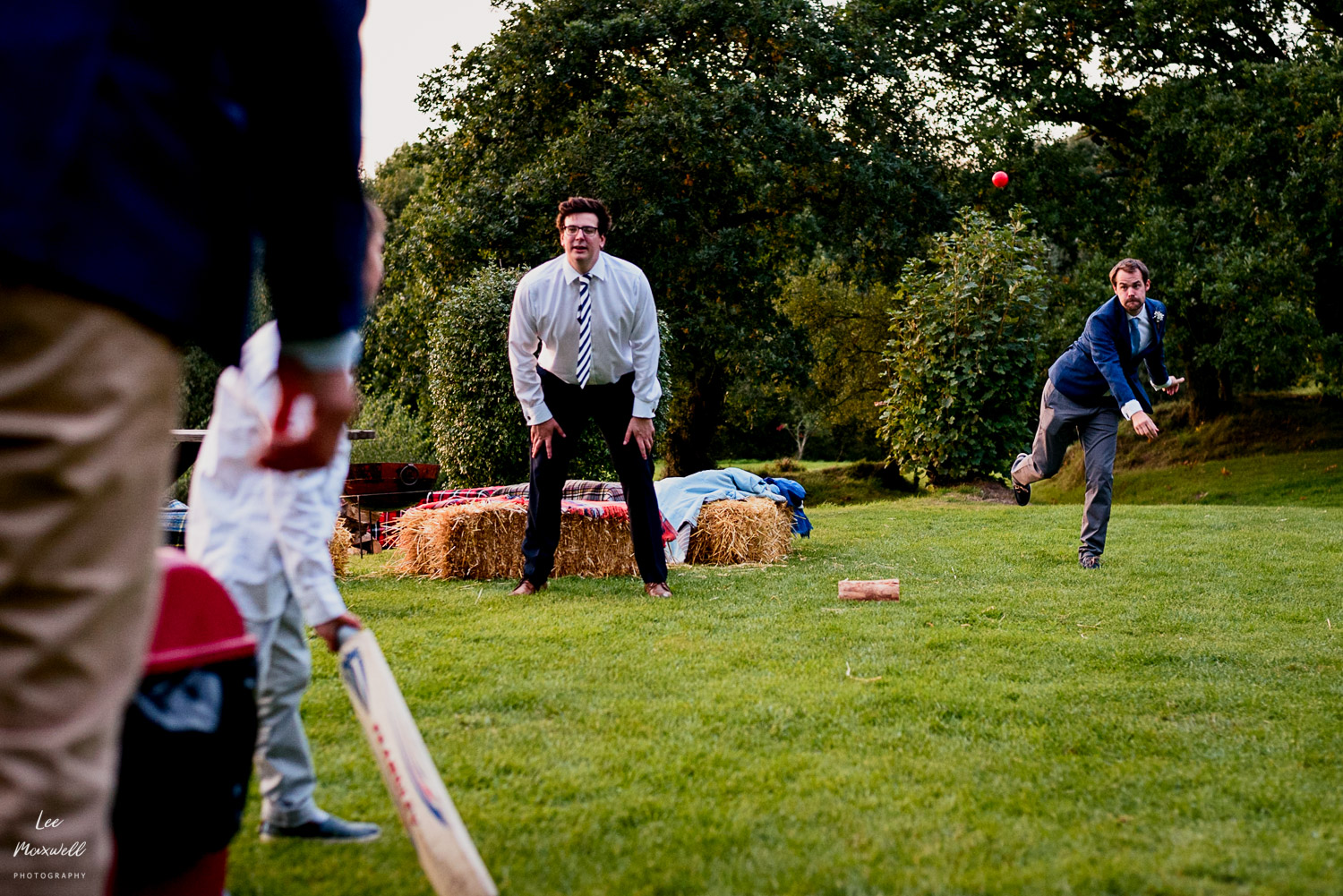 Groom playing cricket