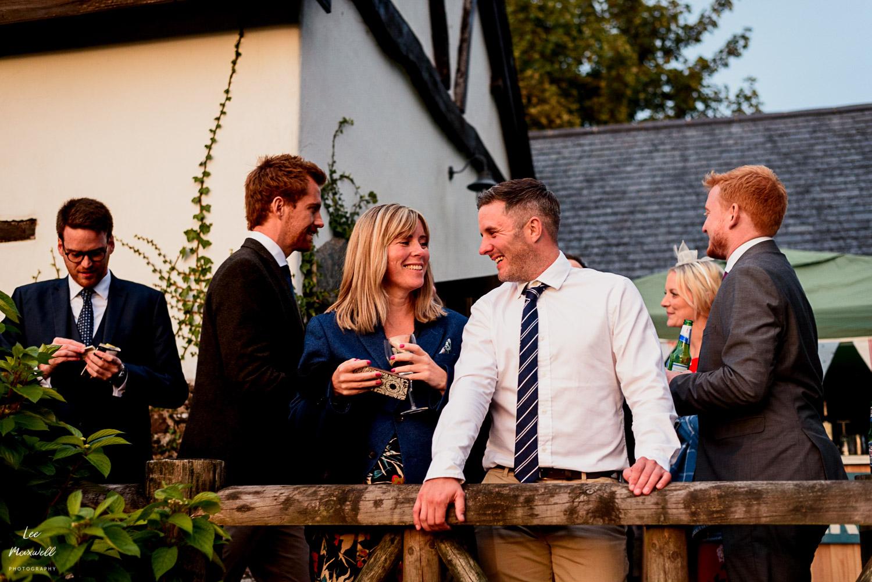 Chatting guests at wedding