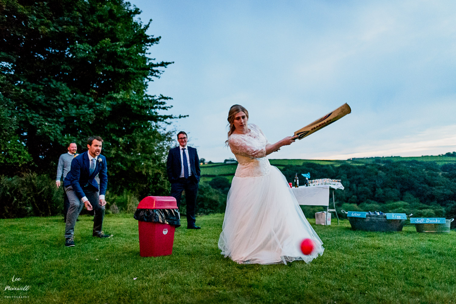 Bride playing cricket