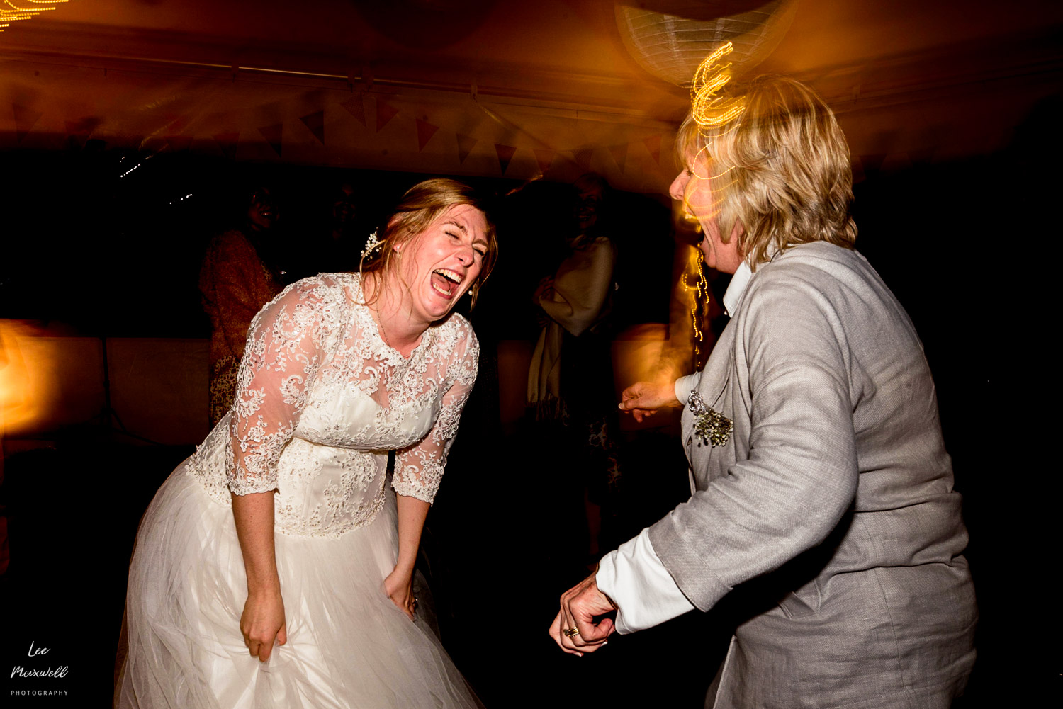 Laughing bride with mum