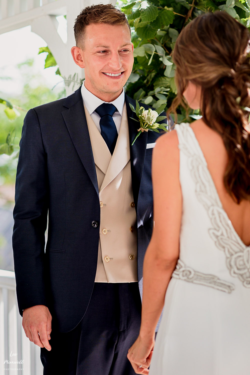 Smiling groom in ceremony