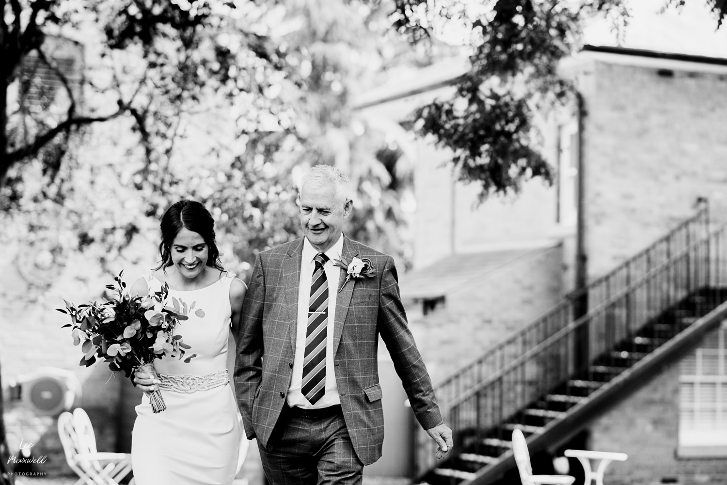 Bride walking with dad