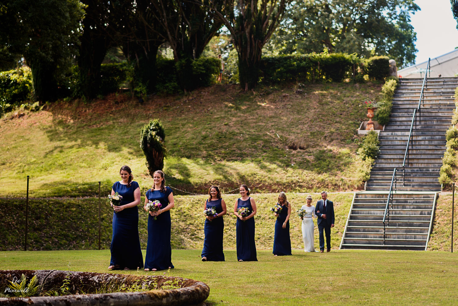 Bridal party walking to the ceremony at Tracey estate
