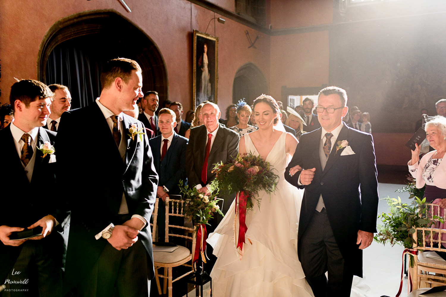 Walking down the aisle at Cowdray Estate