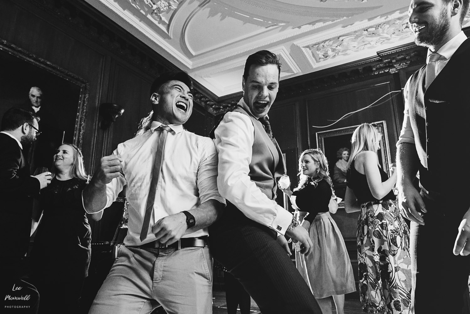 Groom and friend dancing at Cowdray Estate