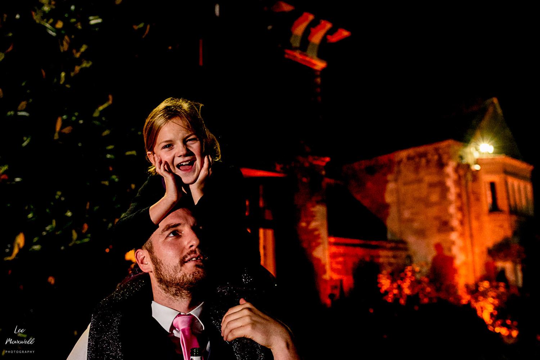 Kid at wedding enjoying fireworks at Cowdray Estate