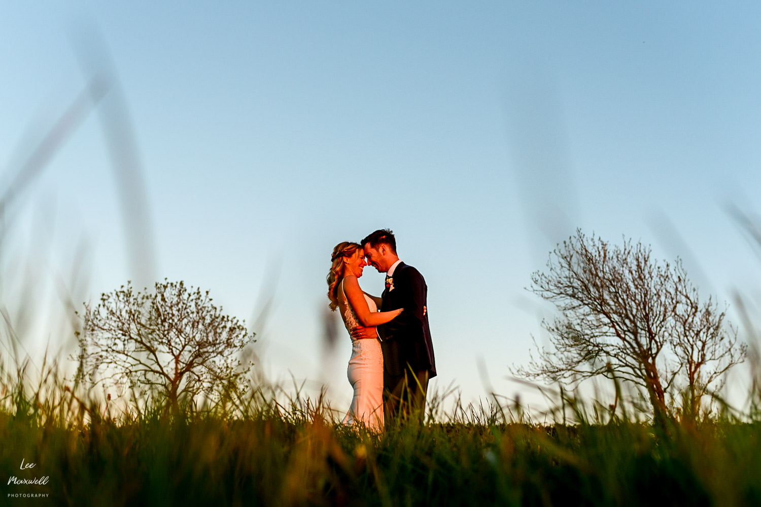 Golden hour wedding at Launcells Barton