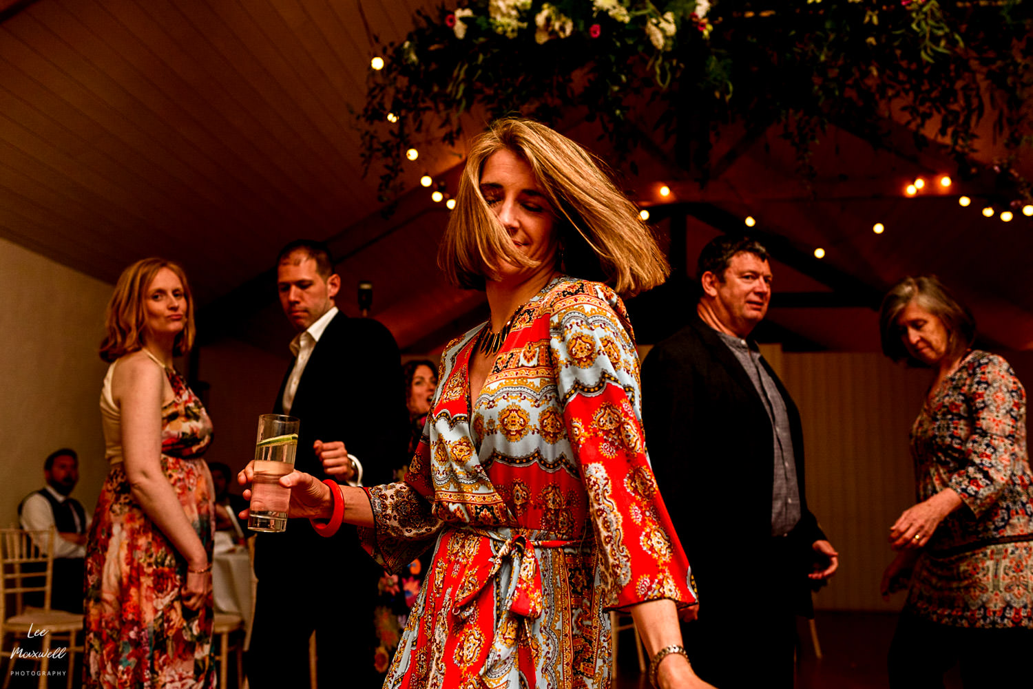 Wedding guest dancing at Launcells Barton