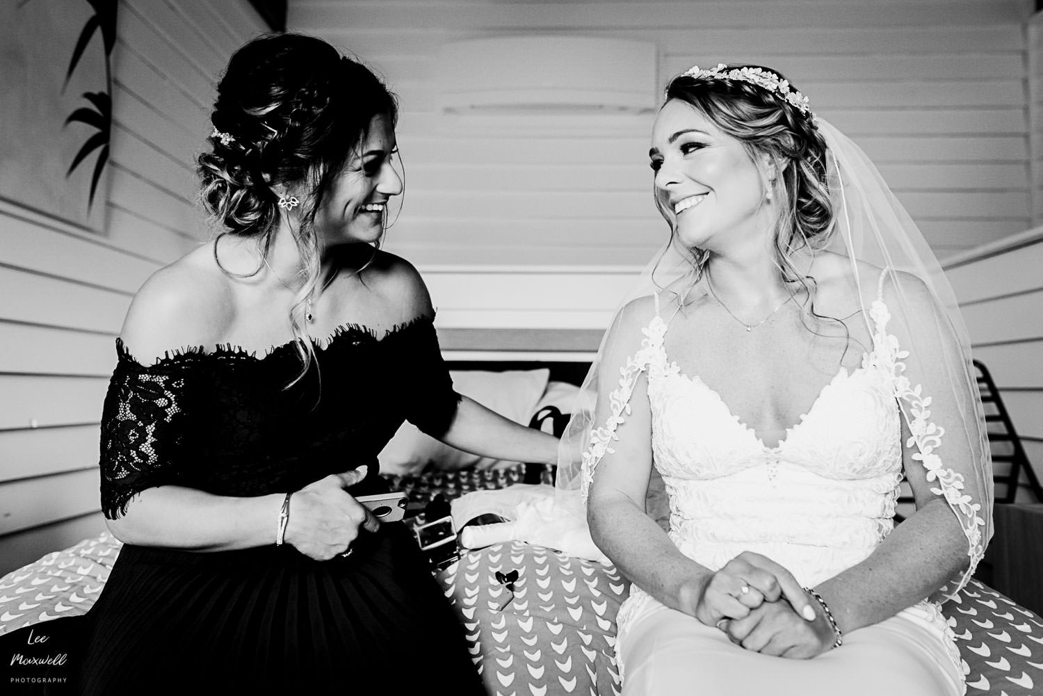 Bride chatting with bridesmaid