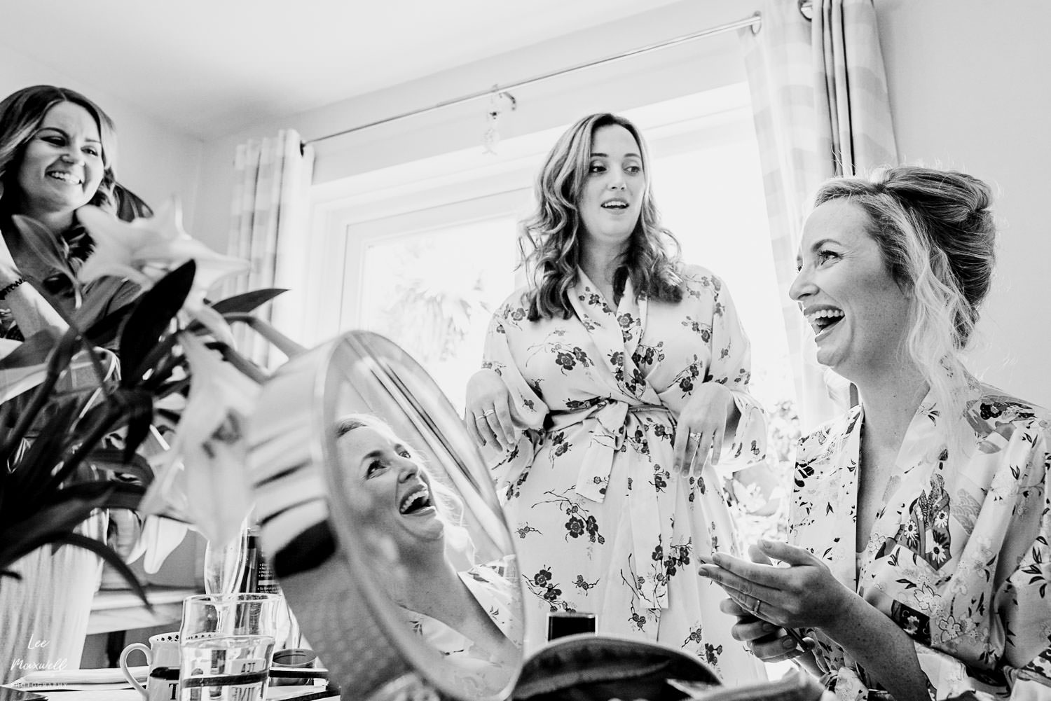 Laughing bride whilst getting ready