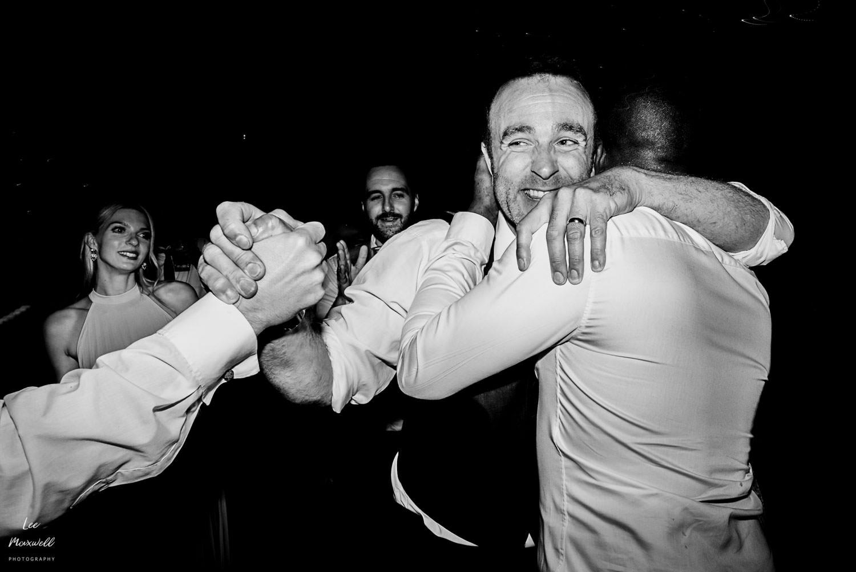 Hugging the groom on the dance floor