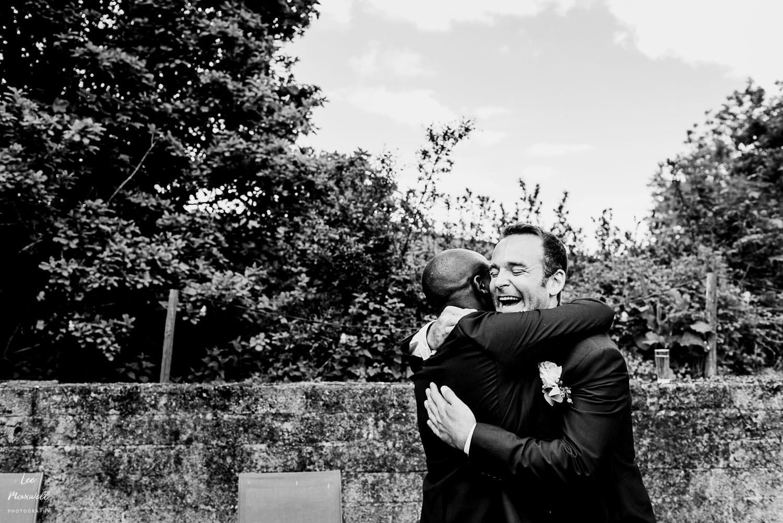 Laughing groom giving a hug