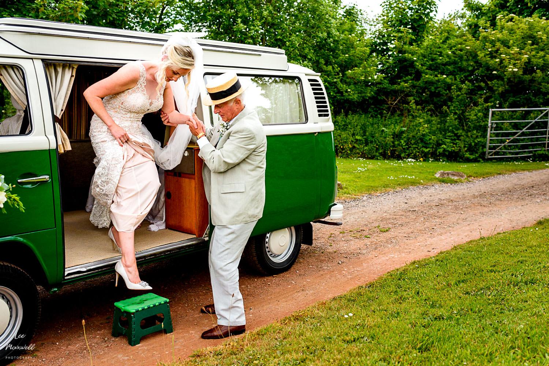 Bride getting out of camper van