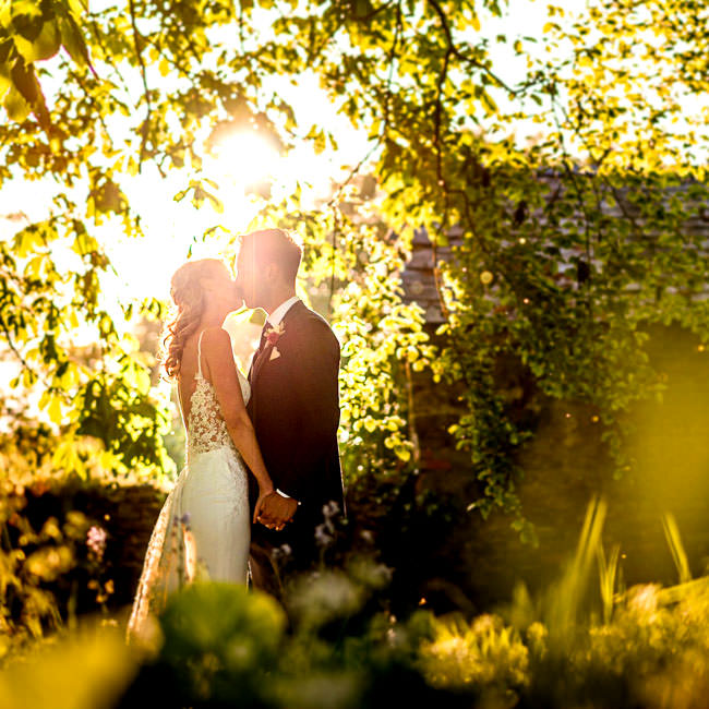 Bride and groom portrait with golden light