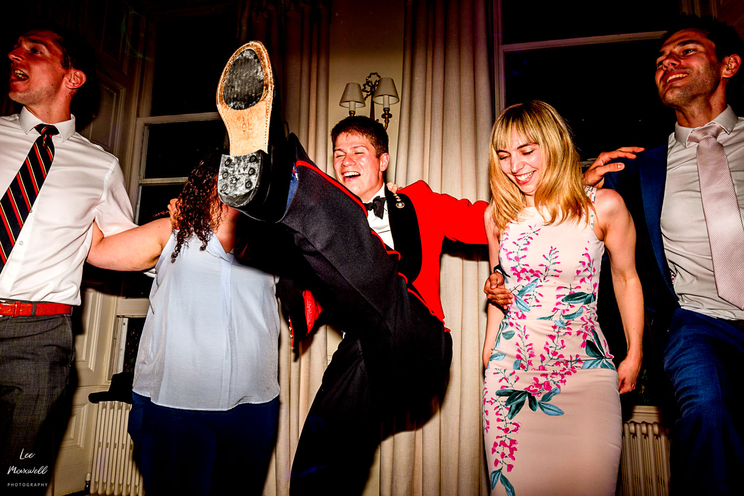 Dancing groom at Pynes House wedding