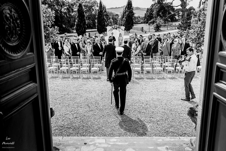 Groom walking to outdoor ceremony