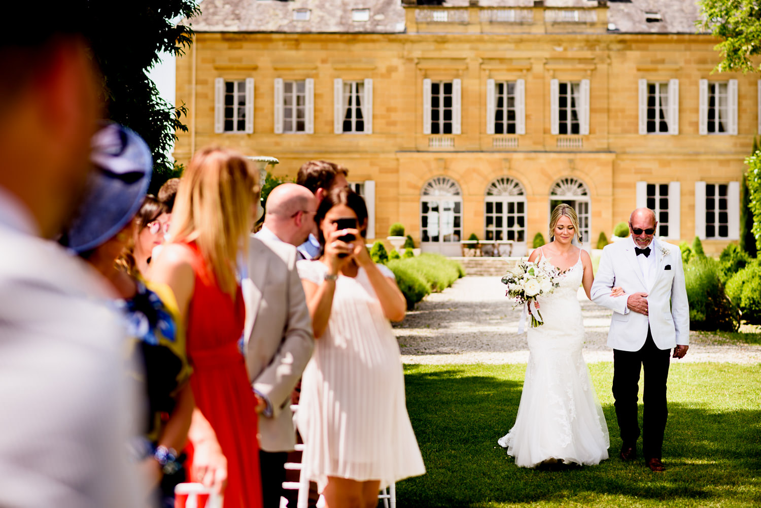 Bride walking down aisle at chateaux wedding