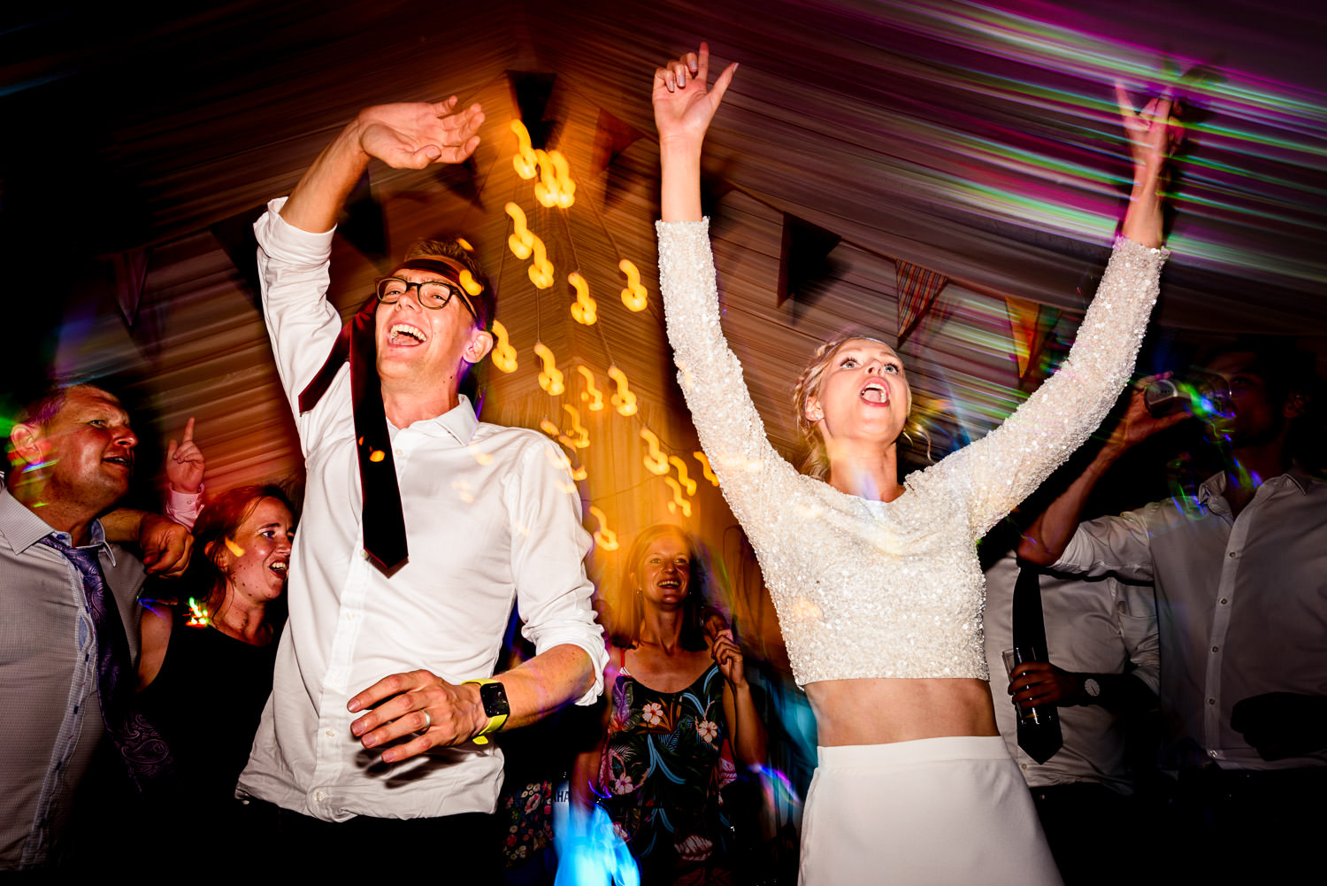 Dancing bride and groom at Devon wedding
