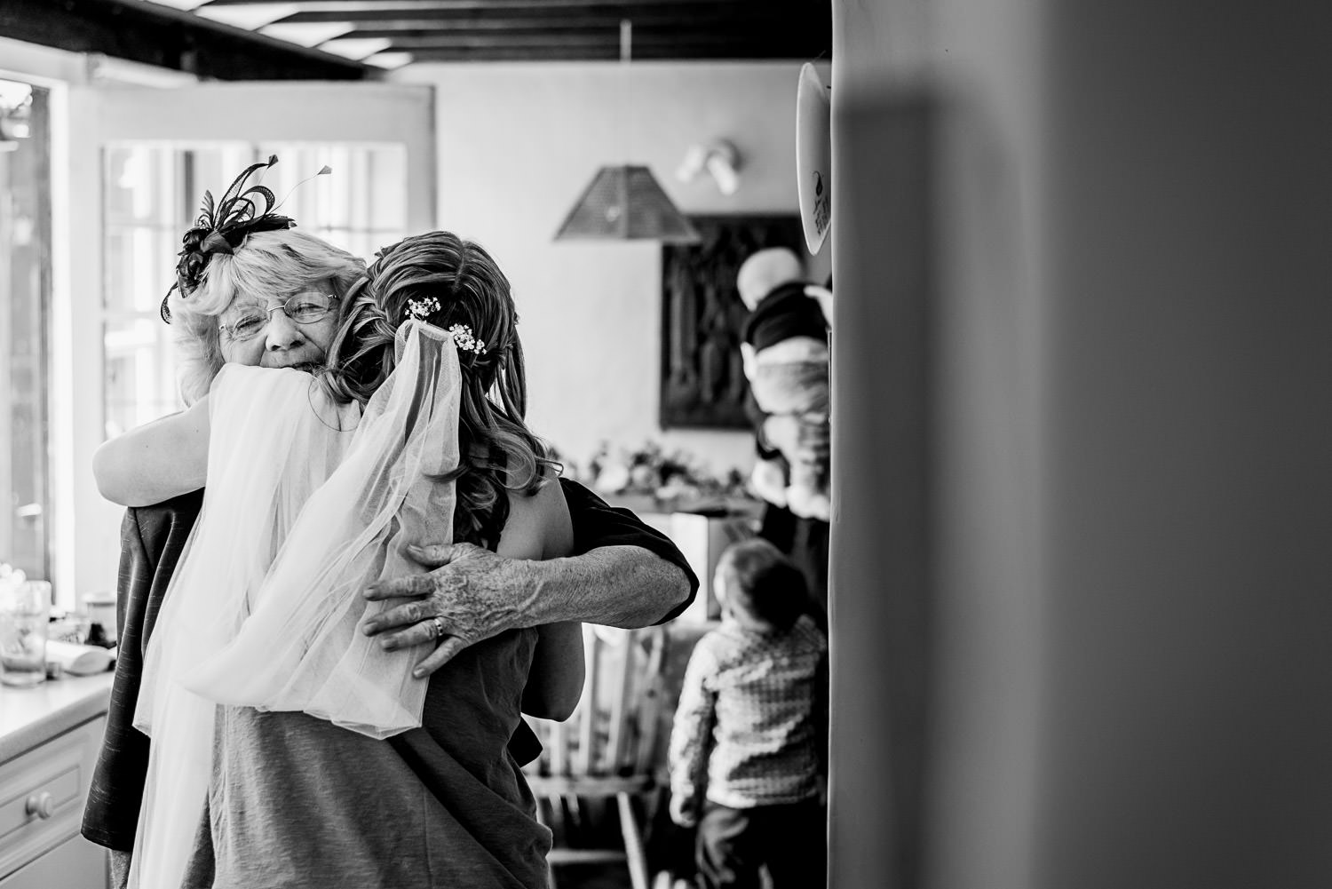 Mother of the bride hugging daughter
