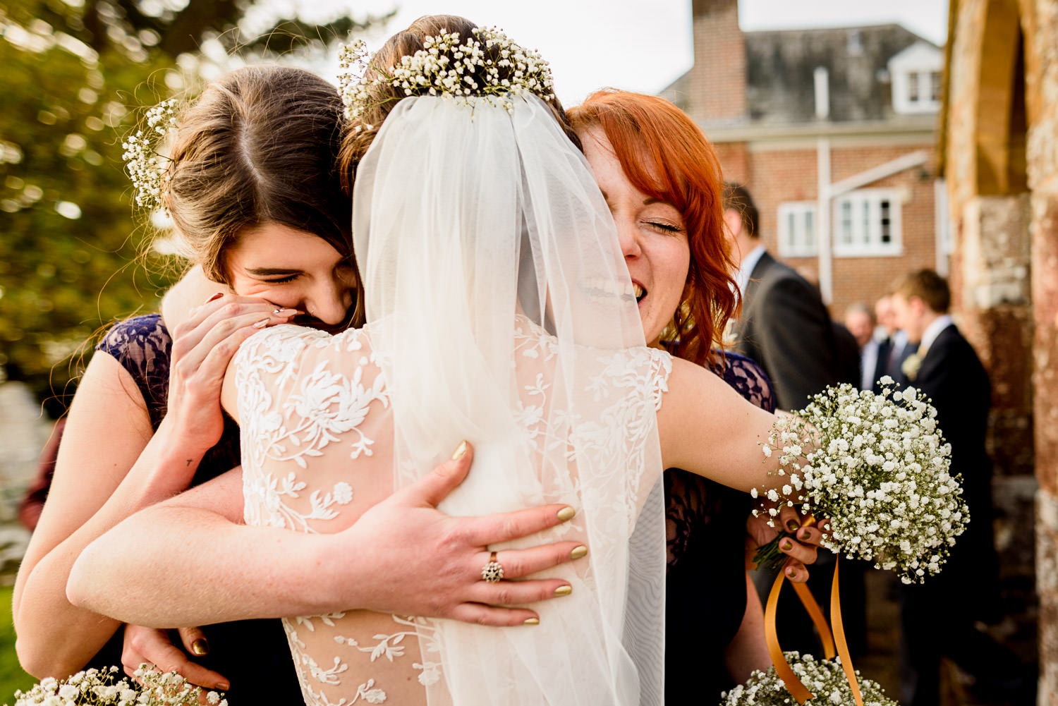 Big hugs for bride at Devon wedding